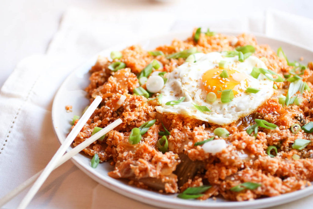 Spicy Kimchi Cauliflower Fried Rice with a Perfect Egg on Top. Grain free, gluten free, paleo, whole30, crazy delicious and done in 15 minutes! abraskitchen.com