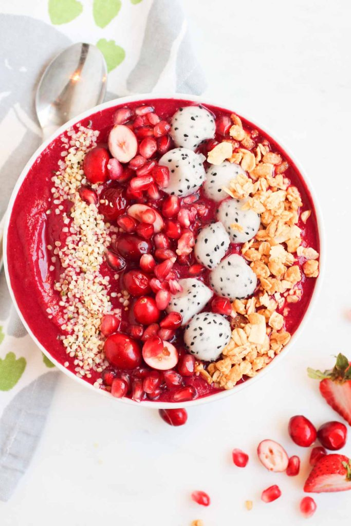 This vegan, gluten-free, beet, pray, love smoothie bowl is the perfect combo of bright red beets and berries, loaded with antioxidants and superfoods. A healthy loving way to begin any day   Abraskitchen.com