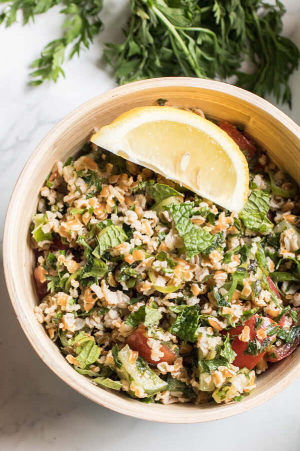 A light refreshing salad filled with fresh herbs, veggies, and heart healthy bulgur. Carrot top tabouli is my favorite summer lunch. Vegan, Plant Strong! |abraskitchen.com