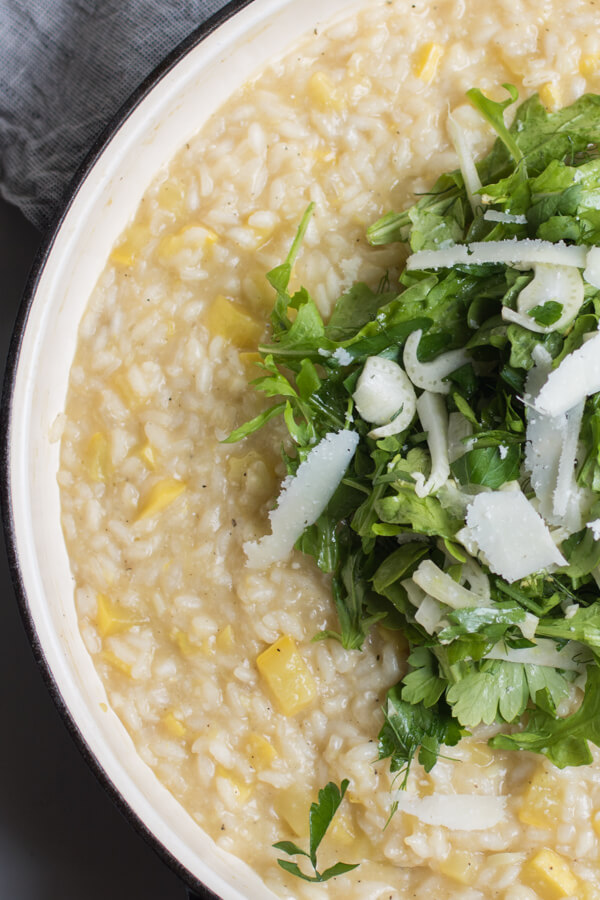 Creamy lemon squash risotto with a salad on top. A few simple healthy ingredients, ready in 35 minutes! Vegetarian and Gluten-Free | abraskitchen.com
