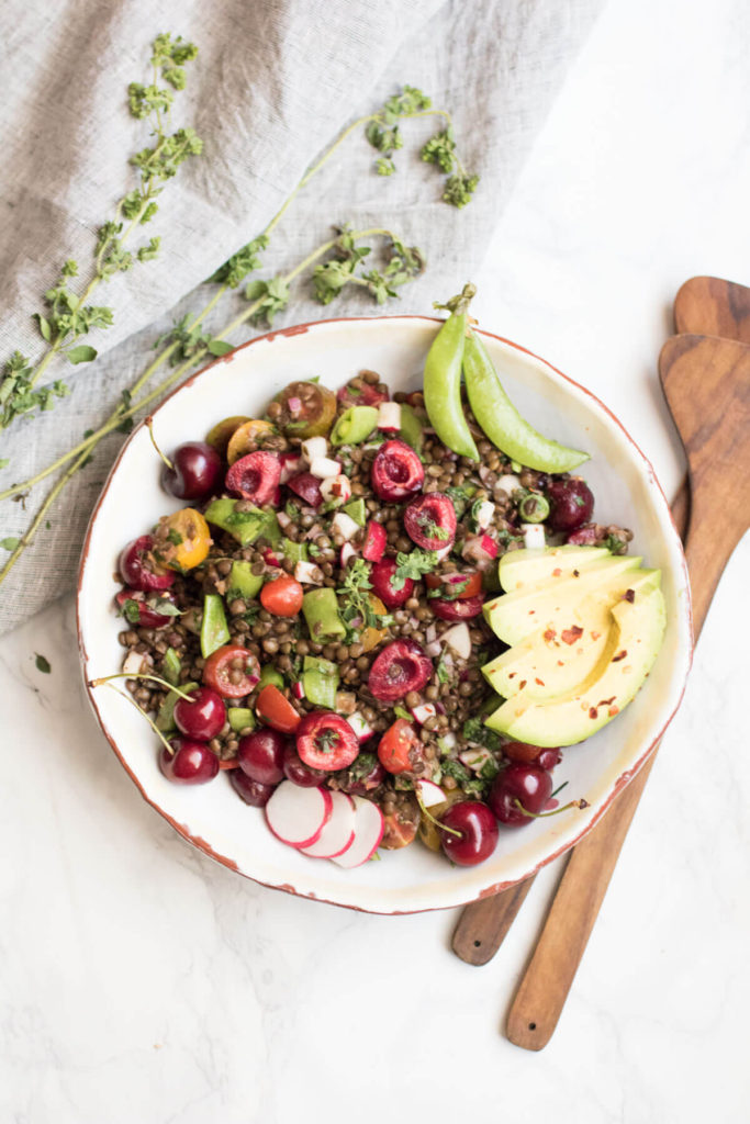 Farmer's market lentil salad with fresh cherries, sugar snap peas, and fresh oregano. A beautiful bounty of healthy local seasonal veggies and protein rich lentils. An easy to make vegan and gluten free summer salad.