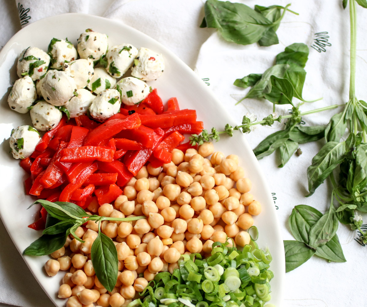 Fresh Basil and Roasted Cauliflower pasta salad - with pasta, roasted cauliflower, fresh mozzarella, chickpeas, roasted bell peppers, and tons of fresh basil. This is the easiest and healthiest vegetarian pasta salad. | abraskitchen.com