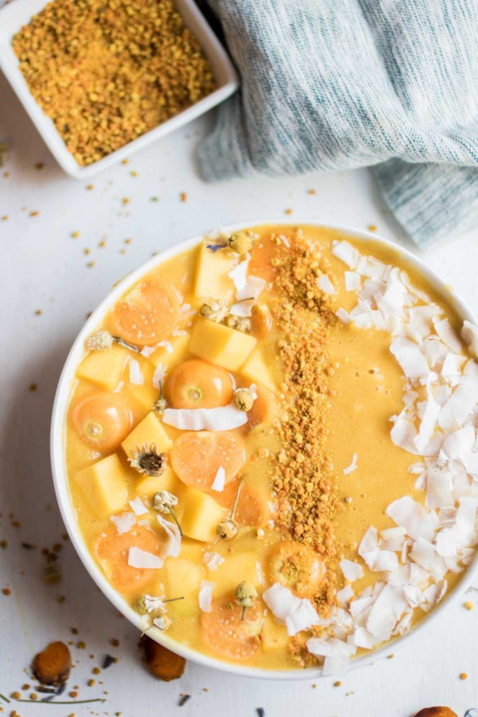 Paleo, Whole 30. Fresh turmeric smoothie bowl, the perfect morning treat! Banana free! The creamy base is cauliflower, mango, lemon, orange, and a few other superfood ingredients to help you beat those seasonal allergies. So yummy!