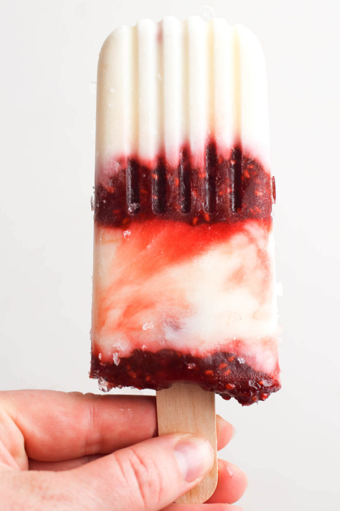 Homemade creamy yogurt popsicles with raspberry rhubarb swirl. A healthy snack or a quick breakfast and only 84 calories!