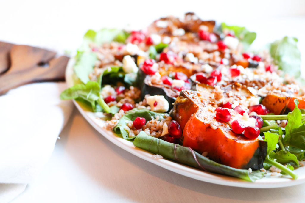 This festive (gluten free) Roasted Acorn Squash Salad with warm Buckwheat, Five-Spice Acorn Squash, Feta Cheese, and Pomegranate Seeds is full of healthy seasonal ingredients and a sweet and tangy maple dijon dressing. Yum! |Abraskitchen.com