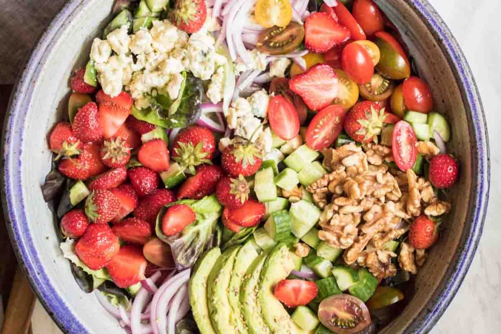 Sweet strawberries, creamy avocado, and addictive blue cheese come together to create the worlds most perfect summer salad.