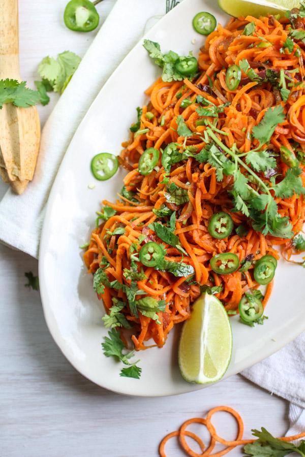 Spiralized sweet Potato Noodles with Jalapeno Lime Dressing, spiralized sweet potato, fresh cilantro, spicy jalapeno and tangy lime juice. Vegan, gluten free, paleo, Whole30| abraskitchen.com