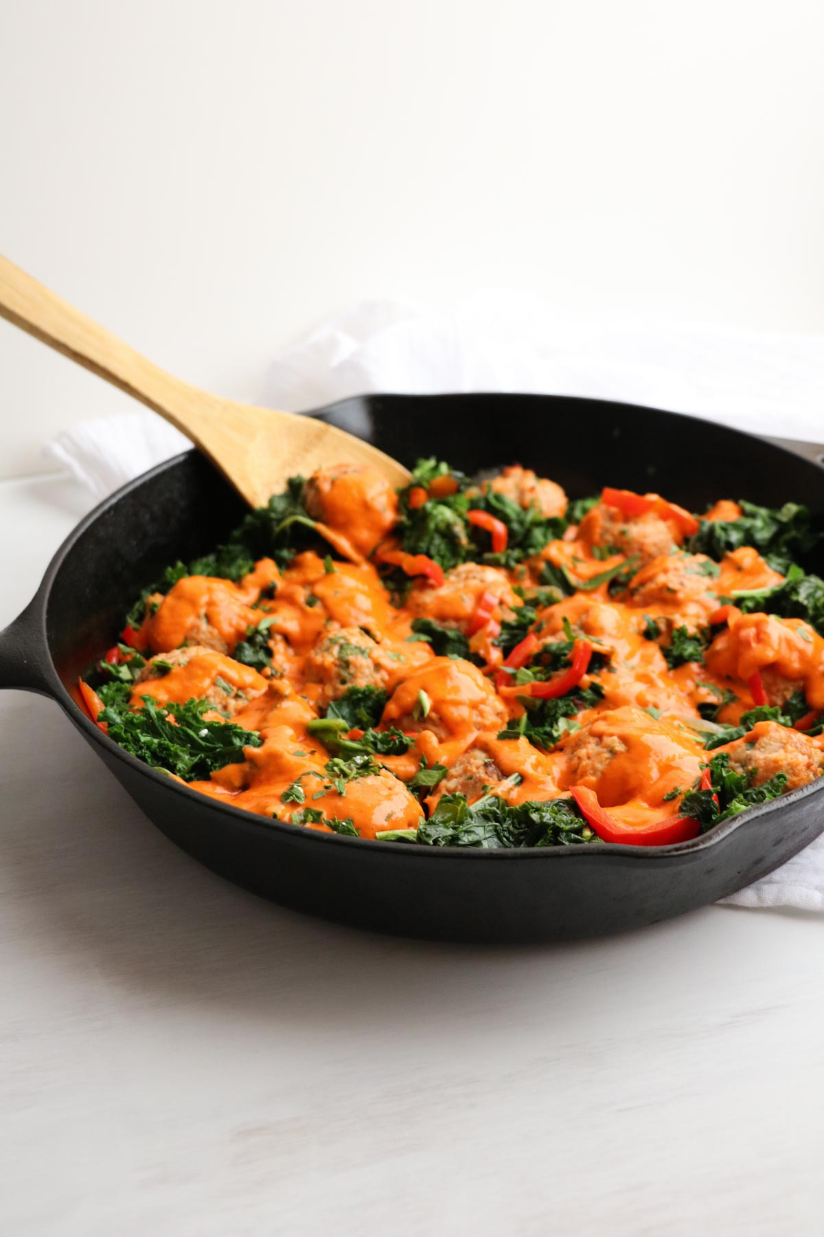The best chicken meatballs in a creamy roasted red pepper feta cheese sauce with sauteed kale. OMG, so good!