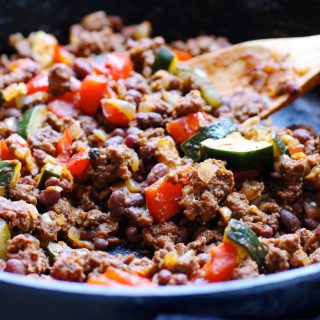 The quick cooking, healthy, easy clean up, entire family happy making, grass fed beef and zucchini skillet supper recipe.