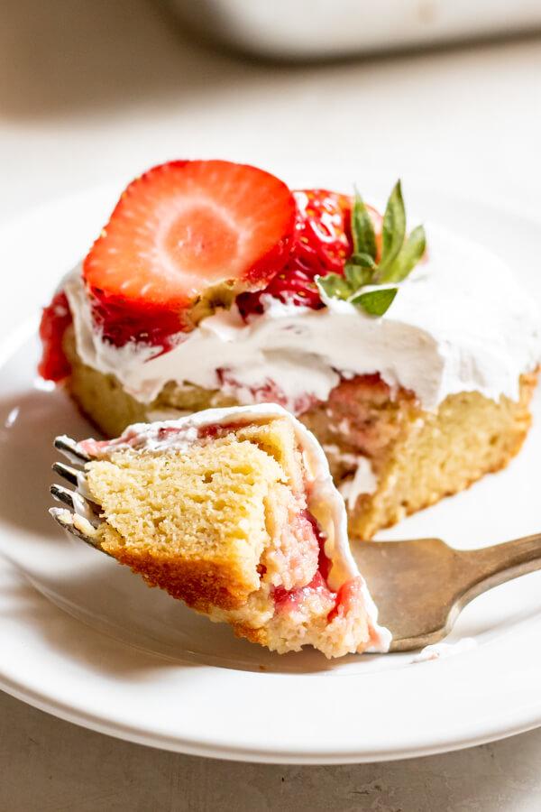 close up shot of Paleo Strawberry Poke Cake on a fork