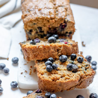 Blueberry Banana Bread made with Oat Flour on a white background, thick slices