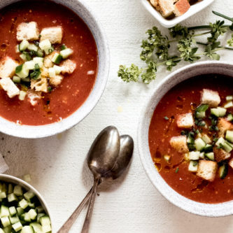 2 bowls of Healthy Charred Gazpacho on a white background