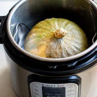 large green kabocha squash inside instant pot