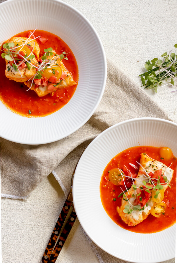 One Pan Cod in Tomato Butter Sauce in white bowls on white surface