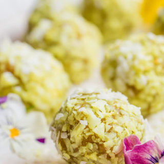 Lemon turmeric energy bites are a seriously delicious healthy snack. One bite of citrus perfection, combining the perfect balance of protein and fat to help you feel full and satisfied. Filled with super healthy ingredients like turmeric, nuts and coconut that boost anti-inflammatory properties and encourage overall health and vitality. These no-bake energy bites are gluten-free, paleo, vegan, and 100% sugar-free. No dates, maple syrup, honey, or stevia, just natural sweetness from coconut and bright tangy citrus. They taste like lemon cake bites and you will love them!