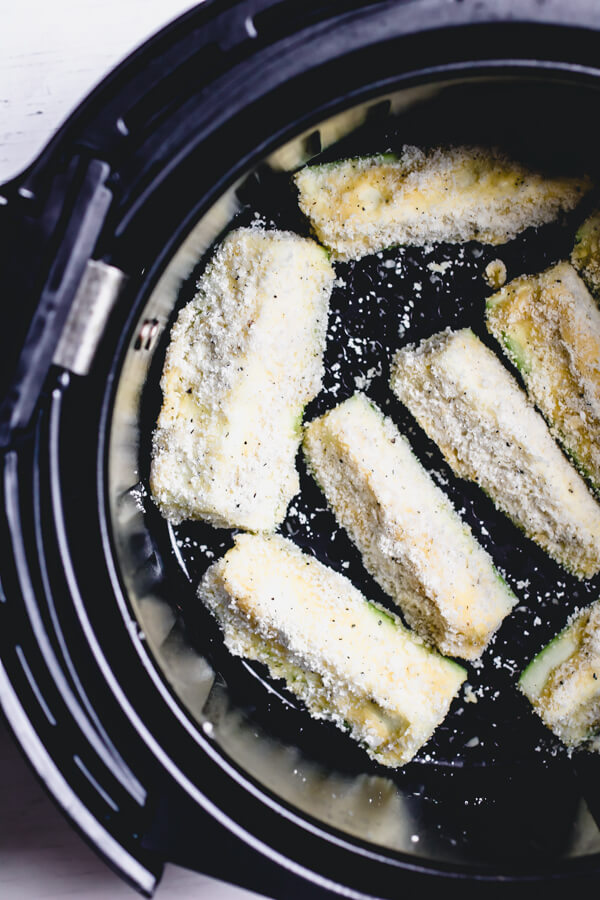 Crispy zucchini fries baked in the air fryer. A gluten-free, paleo version plus a more traditional bread crumb version. A crispy healthy snack, ready in 15 minutes!