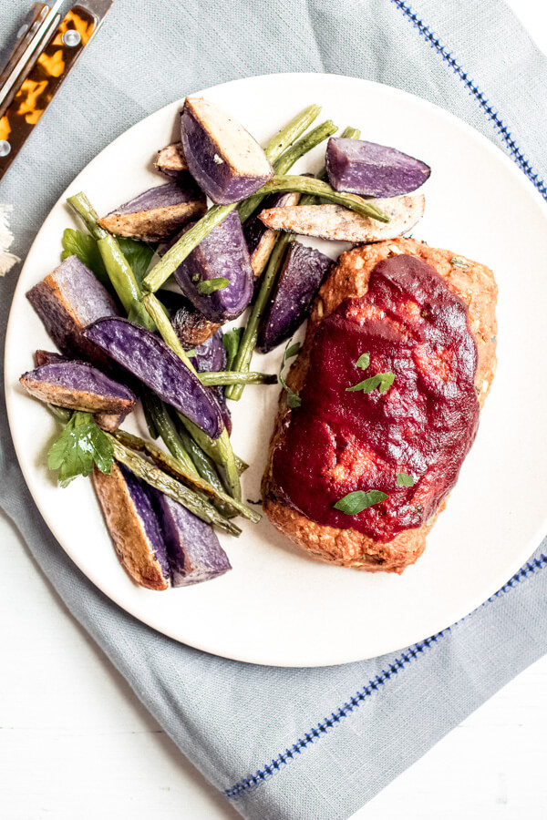 Sheet Pan Mini Meatloaves with purple potatoes and green beans, your busy weeknight healthy dinner savior. Delicious nourishing comfort food cooked on one pan for easy cleanup!