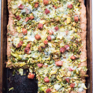 Insanely delicious Brussels sprout pizza with crispy bacon and crumbled blue cheese. 5 ingredients, 20 minutes, one sheet pan. Pizza perfection. |Abraskitchen.com