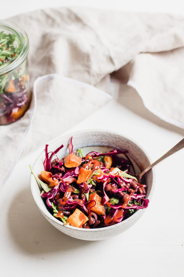white bowl full of Black Bean and Butternut Squash Jar Salad