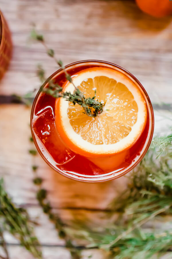 Ring in the holidays with a refreshing and delicious low alcohol cocktail. A twist on a traditional Americana Cocktail using kombucha for a little extra gut health love. The perfect light cocktail for a holiday party!