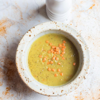 Vegan Coconut Split Pea Soup, loaded with warm spices and creamy coconut milk. This isn't your Grandmas' split pea soup!