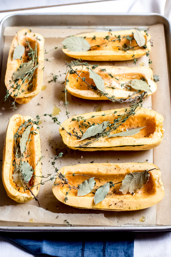 Creamy Kale and Mushroom Stuffed Delicata Squash on a platter