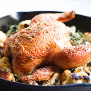 One pan easy garlic thyme roast chicken with cauliflower is the only recipe you will ever need for whole roasted chicken.Cast Iron Skillet, Paleo, Gluten Free |abraskitchen.com
