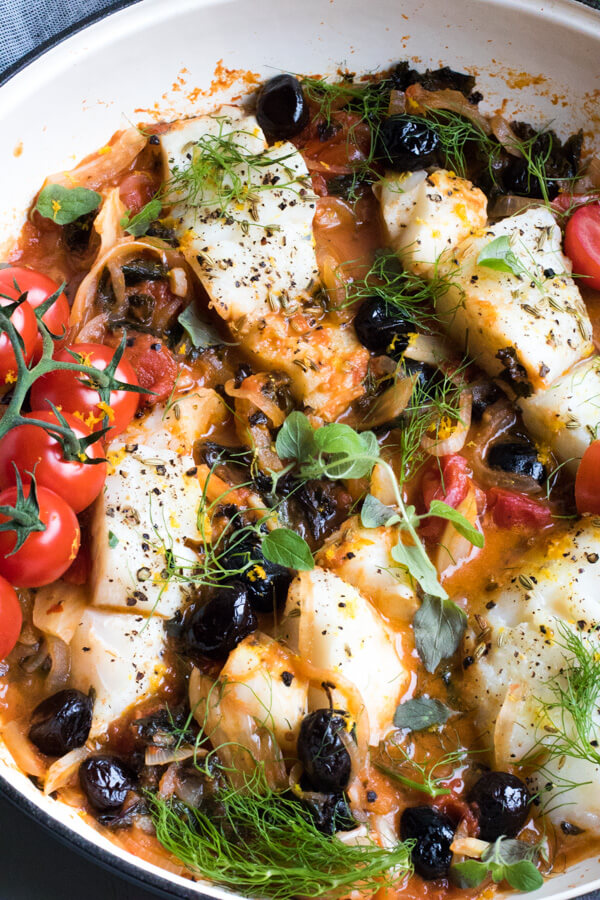 Easy One Pan Mediterranean Cod. A super healthy dinner, cooked all in one pan and ready in 30 minutes! Paleo, Gluten Free, Pescatarian, and Whole 30