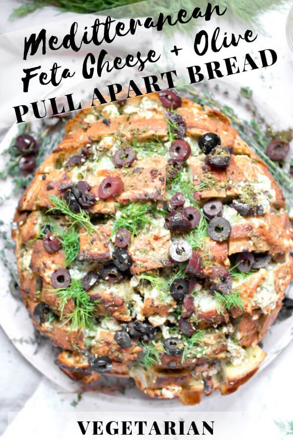 Feta Cheese and Olive Pull Apart bread, ooey gooey cheesy bread with briny salty olives, fresh herbs, and garlic. It is in all ways amazing! The perfect appetizer to serve to a large crowd. #vegetarian #pullapartbread #superbowlfood