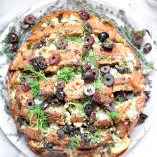 Feta Cheese and Olive Pull Apart bread, ooey gooey cheesy bread with briny salty olives, fresh herbs, and garlic, and it is in all ways amazing! The perfect appetizer to serve to a large crowd.