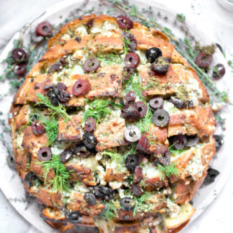 Feta Cheese and Olive Pull Apart bread, ooeygooey cheesy bread with briny salty olives, fresh herbs, and garlic, and it is in all ways amazing! The perfect appetizer to serve to a large crowd.