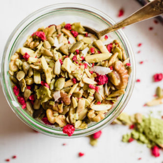 A super simple grain-free granola recipe with matcha green tea powder, coconut, and dried raspberries. Low carbohydrate, paleo friendly, vegan, and addictively good!