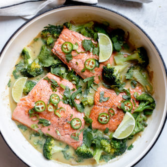 Green curry salmon in one pan on white background