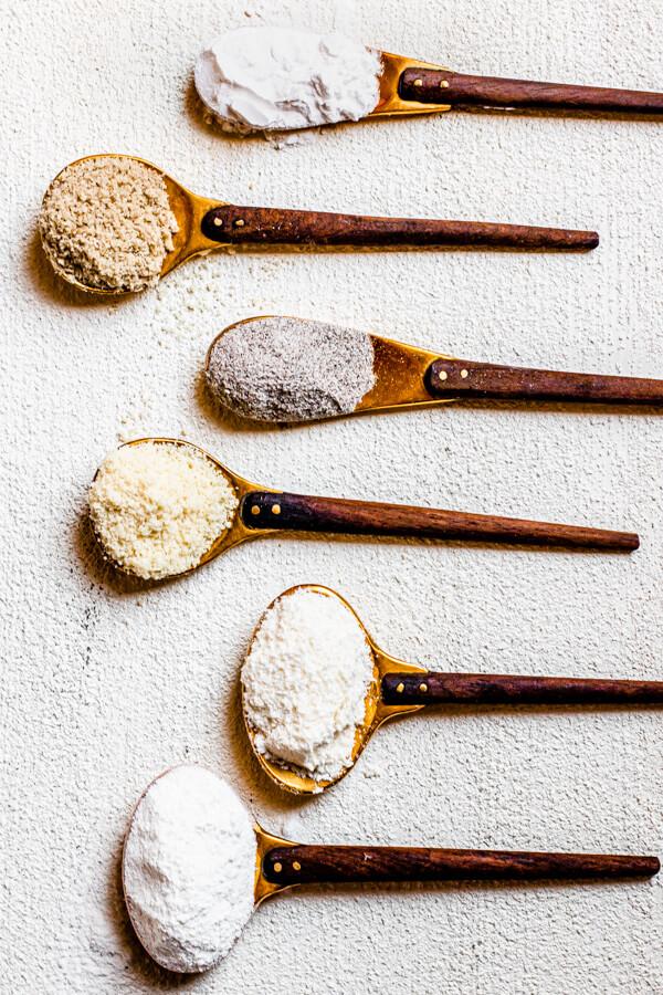 Healthy Flour Guide, 10 healthier flour alternatives to white flour on golden spoons