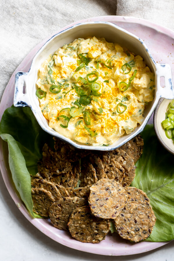 bowl of Healthy Greek Yogurt Egg Salad with Turmeric with crackers on the side