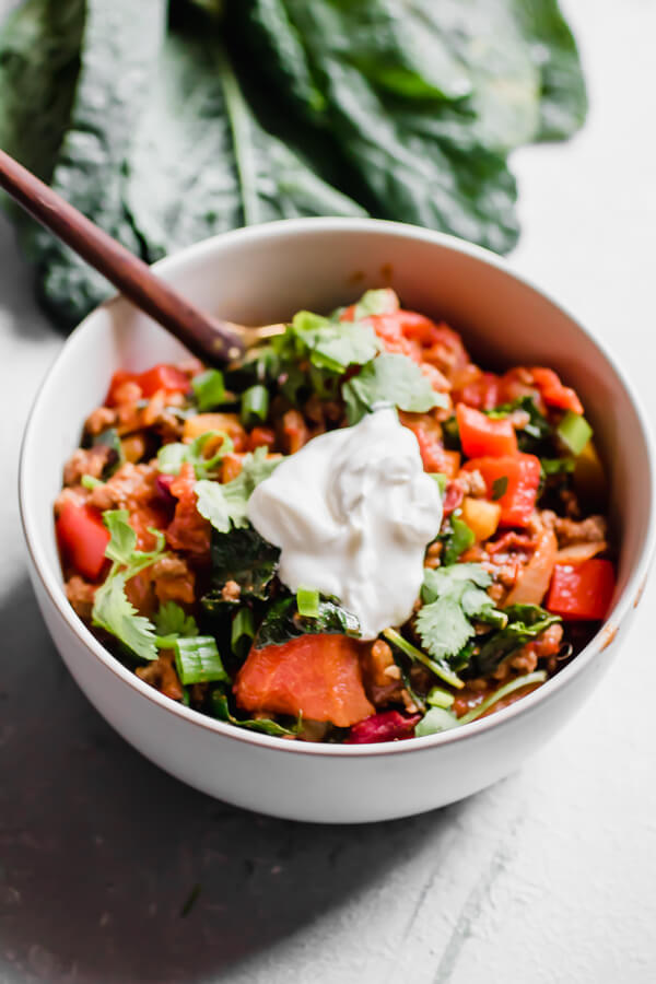 30 minute quick and healthy kale and grass-fed beef chili, loaded with good for you veggies and the perfect amount of spices. Perfect for a healthy quick weeknight meal or a long lazy Sunday afternoon. Chili, but healthier.