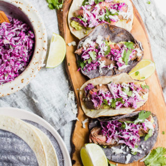 Quick and easy healthy steak tacos topped with a mouthwatering lime cilantro coleslaw.