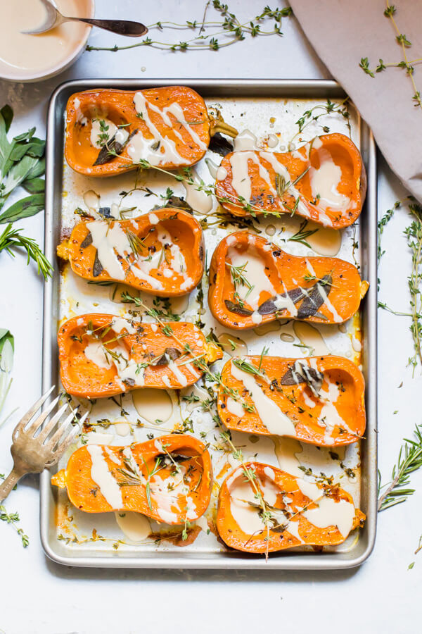 Mouthwatering herb roasted honeynut squash with a miso tahinisauce. Perfect for a quick weeknight meal, or a festive holiday side dish. Gluten-free, vegan, paleo.