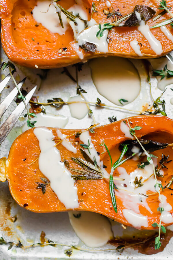 Mouthwatering herb roasted honeynut squash with a miso tahini sauce. Perfect for a quick weeknight meal, or a festive holiday side dish. Gluten-free, vegan, paleo.