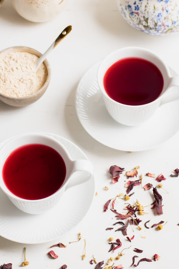 Hibiscus Adaptogen Latte is a warm comforting drink to sip all winter long, bright health promoting hibiscus flowers pair with calming chamomile and a touch of adaptogenic power from ashwaghanda. Cozy up to a warm mug of this stress-reducing, sleep-promoting, and all around feel good warm adaptogen latte.