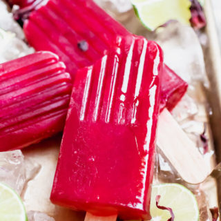 Refreshing and hydrating Hibiscus Lime-Aid Popsicles. Requires only four wholesome ingredients, sweetened with raw honey.