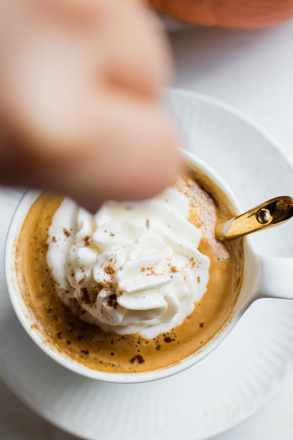 A creamy delicious fall treat, homemade pumpkin spice latte! Using maple syrup, real pumpkin, oat milk, and spices. Homemade is a million times better than store bought, and takes about 2 minutes to whip up!