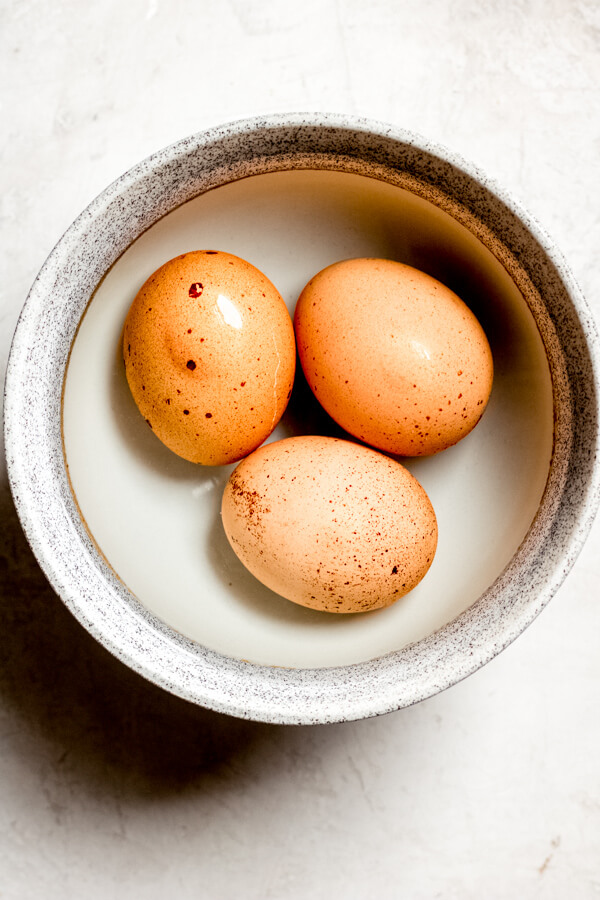 eggs in shell in a grey bowl