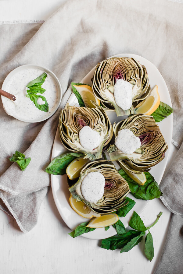 Simply steamed artichokes made quick and easy in the Instant Pot. Yielding perfectly tender results. Ideal as a healthy appetizer, side dish or snack, paired with a healthy and delicious parmesan basil dip!