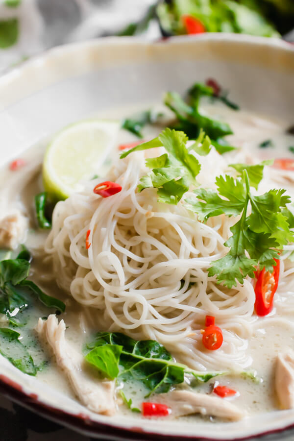 Instant Pot Thai Coconut Lime Chicken Soup with Noodles - A fragrant, warm, fresh and zesty soup that is insanely delicious and super good for you! Start with a whole chicken, fragrant herbs and spices, and thanks to the instant pot, dinner is done in 30 minutes!