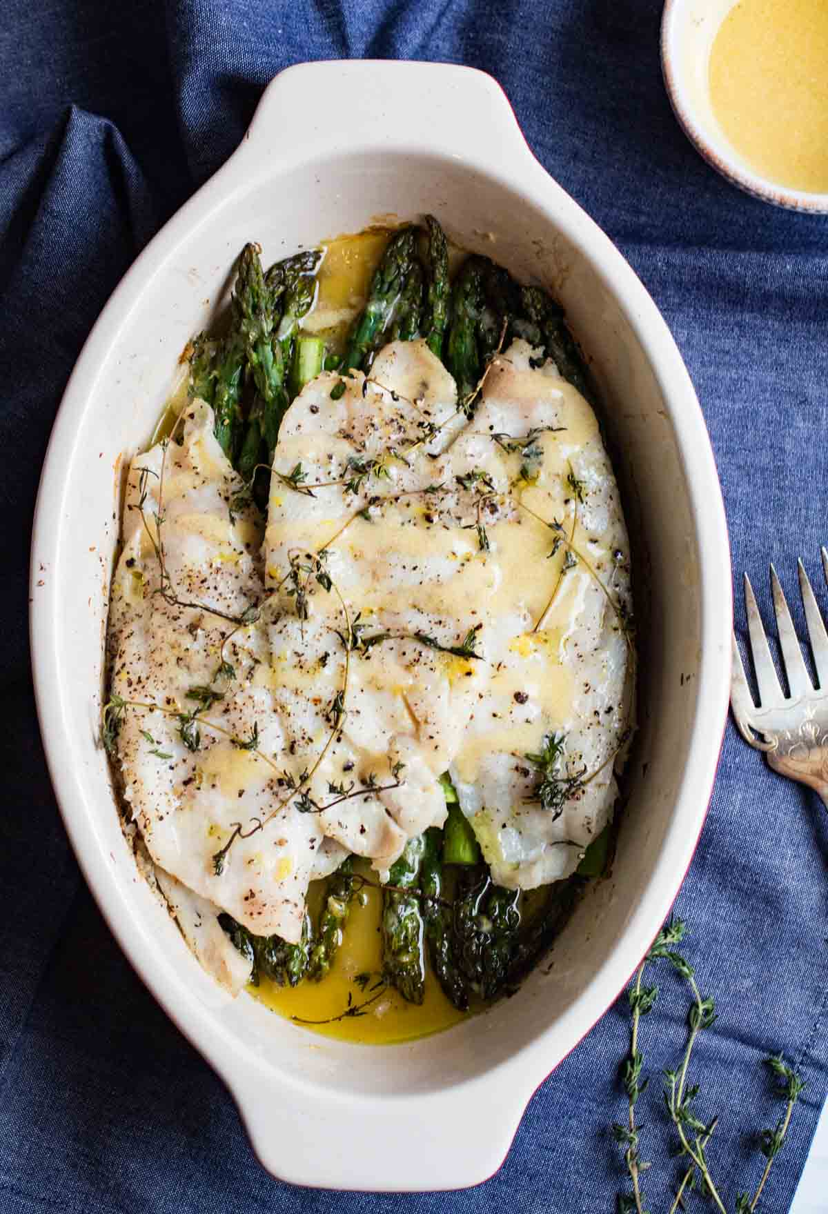 Lemon Thyme Roasted Sole and Asparagus with a creamy dijon lemon sauce. A delicious easy to prepare roasted fish dish that is gluten free, paleo friendly, and whole 30 compliant. Spring is here, and you should celebrate with this perfectly seasonal roasted sole. |abraskitchen.com