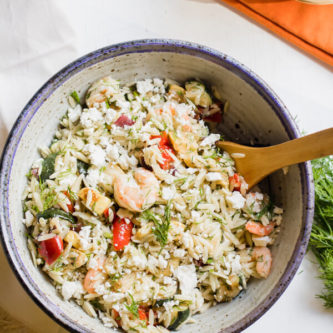 Loaded with fresh roasted vegetables, shrimp, dill, and feta cheese this Mediterranean inspired lemony orzo salad is a quick and easy summer side dish and is fantastic served warm or cold.