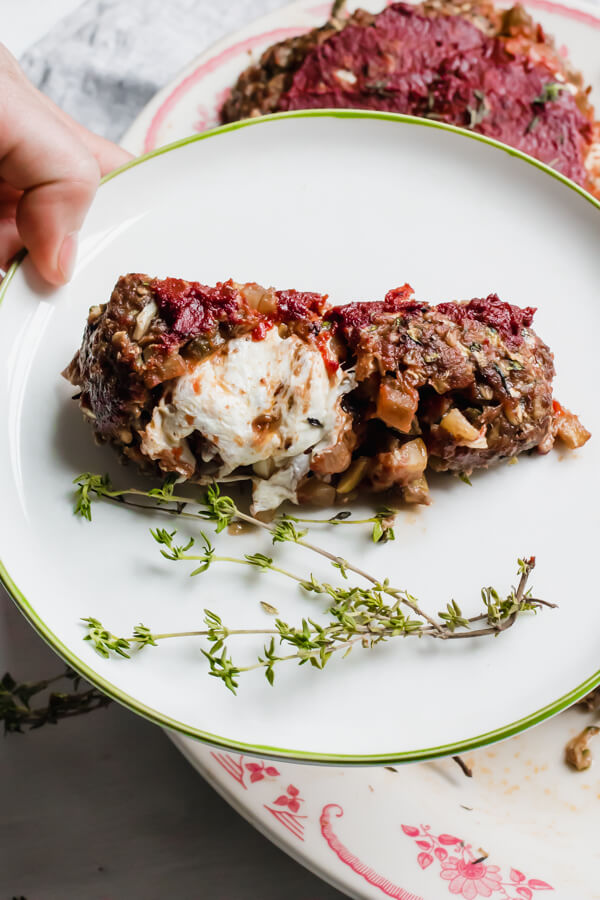Veggie loaded tender meatloaf stuffed with yummy rich tomato ratatouille and ooey gooey mozzarella cheese. Meatloaf has officially been upgraded.  #meatloaf #glutenfree #healthy |abraskitchen.com