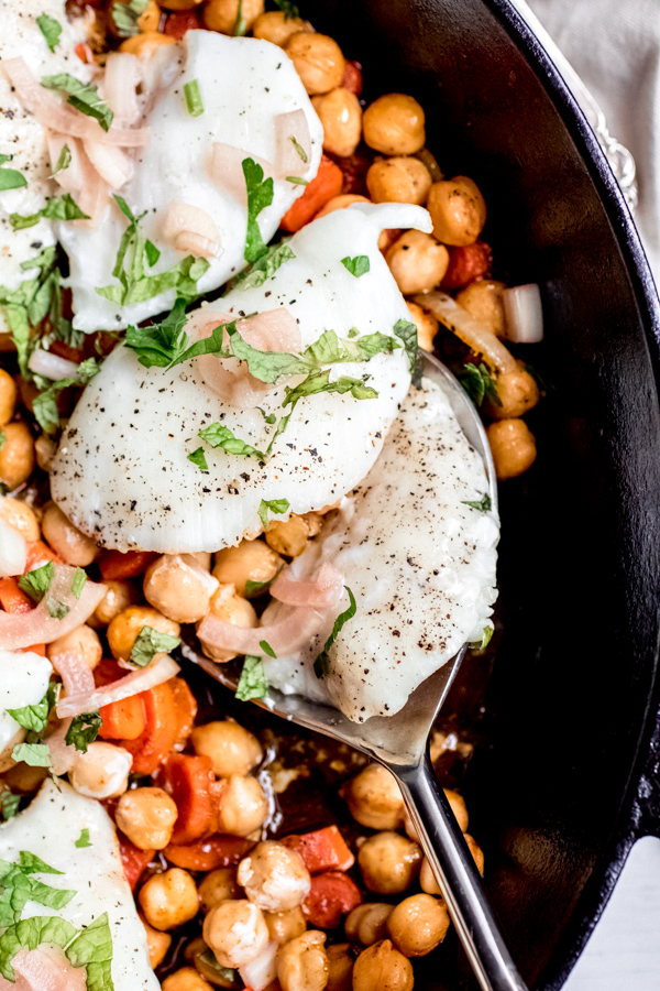 Up close shot of baked halibut with chickpeas