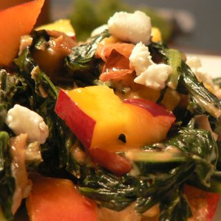 dandelion greens with nectarine and goat cheese